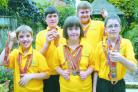 Deserved winners: Worcestershire Special Olympics members Jordan Watts, Matthew Jones, Ellie Jones, Martin Jones and Tom Keeley show off the medals from the National Games. PICTURE: MIRIAM BALFRY
