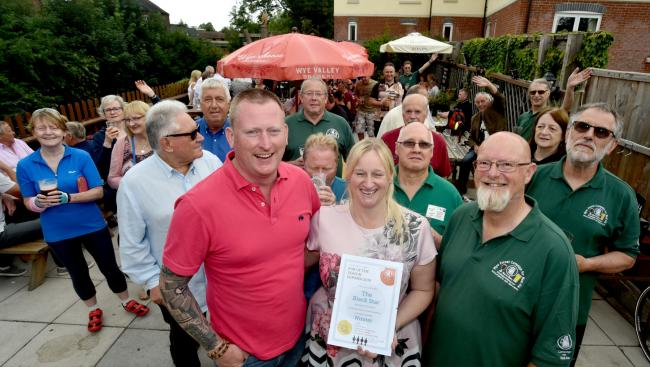 Customers and Wyre Forest CAMRA members with Andy and Maria Gooding receiving their award from Branch Chair Nick Yarwood. PIC: Colin Hill