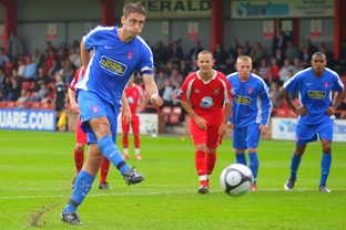 Spot of bother: Chris McPhee scores Harriers' penalty in the 2-1 loss at Tamworth. Picture: ADRIAN HOSKINS