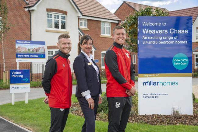 Harry Higginson and Correy Davidson, of the Kidderminster Harriers, with Encarna Garrido from Miller Homes Midlands