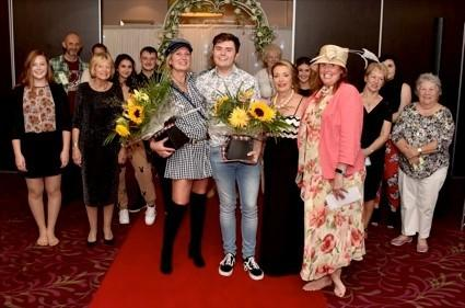 Dress for Less winner Sam Boulton with runner-up Janet Langford (left) and Mary Forrester and Clare Timmins, joint third place, celebrating with other models.
