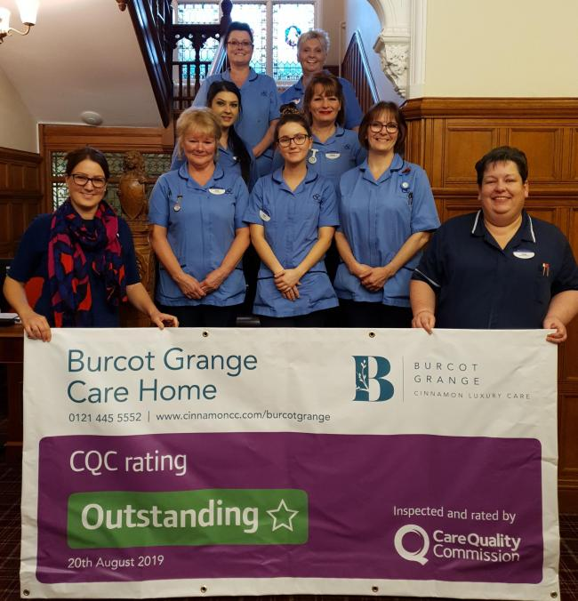 Staff at Burcot Grange celebrate the 'outstanding' rating.