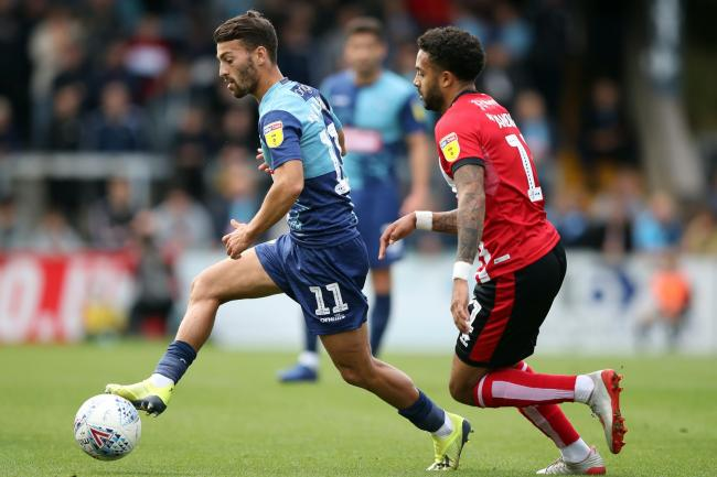 Wycombe forward Scott Kashket (left) has been suspended for breaking betting regulations