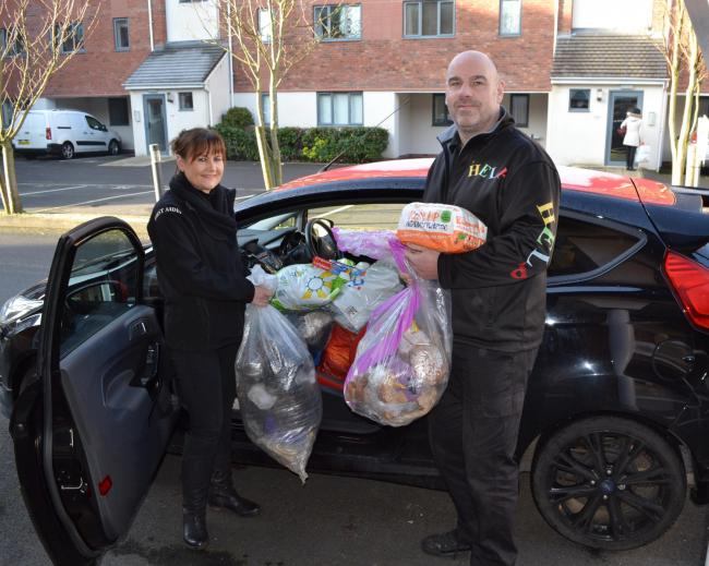 HELP volunteers Jo Ridsdill-Wardle and Dave Griffin with a week's worth of donations