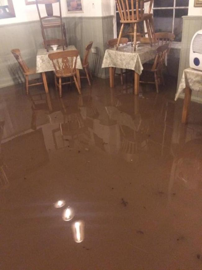 Gil Hancox says the flood water inside his tearoom in Wolverley was two feet high