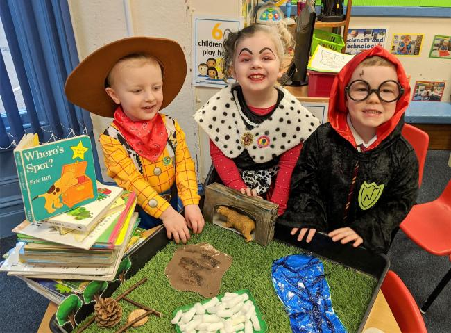 "The children at Kidderminster's Little Trinity Nursery shared a wonderful week and dressed up as their favourite book character to celebrate World Book Day on Thursday 5th March. Nursery Manager, Gaynor Carter, said: ""Each class throughout the week focused on their favourite stories. ""Yellow Bumble Bee room enjoyed 'Going on a Bear Hunt' and 'Dear Zoo' whilst our Red Ladybird room enjoyed reading 'The Enormous Turnip', 'Elmer' and 'Who am I asked the Butterfly?' with activities including going on a minibeast hunt, looking at the butterfly lifecycle and preparing a butterfly garden ready for the baby caterpillars when they finally arrive in a few weeks' time."" They also enjoyed story sacks and mirror play, looking at similarities and differences as well as taking part in role play activities using facemasks and using the 'Bear Hunt' tuff tray for small world play as well as enjoying a Superhero themed lunch.  In a week-long celebration of books, ninety-four children took part with the highlight being children and staff dressing up as their favourite characters on World Book Day.  Added Gaynor: ""We celebrate World Book Day every year because language, literacy and communication is such a vital part of a child's learning and story time is very often their favourite time of the day.  ""Encouraging reading and enjoyment of books is part of our weekly activities, with our lending library offering the children a chance to choose a book that they can then take home and share with their families. World Book Day is a great excuse to simply have fun, share stories, enjoy a favourite book and dress up. What an amazing week!""  Image details from L to R: Little Trinity Nursery children 3-year old Oliver Need, 4-year old Felicity Janes and 3-year old Harry Parsons having fun on World Book Day."