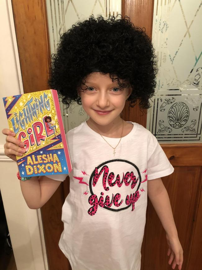 Evie, age 9, dressed as Aurora Beam- Lightning Girl for World Book Day ⚡️