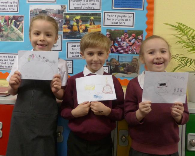 Year two pupils (from left) Ava Wilkes, Alexander Mattinson, and Jessica Evans, with their water safety posters.