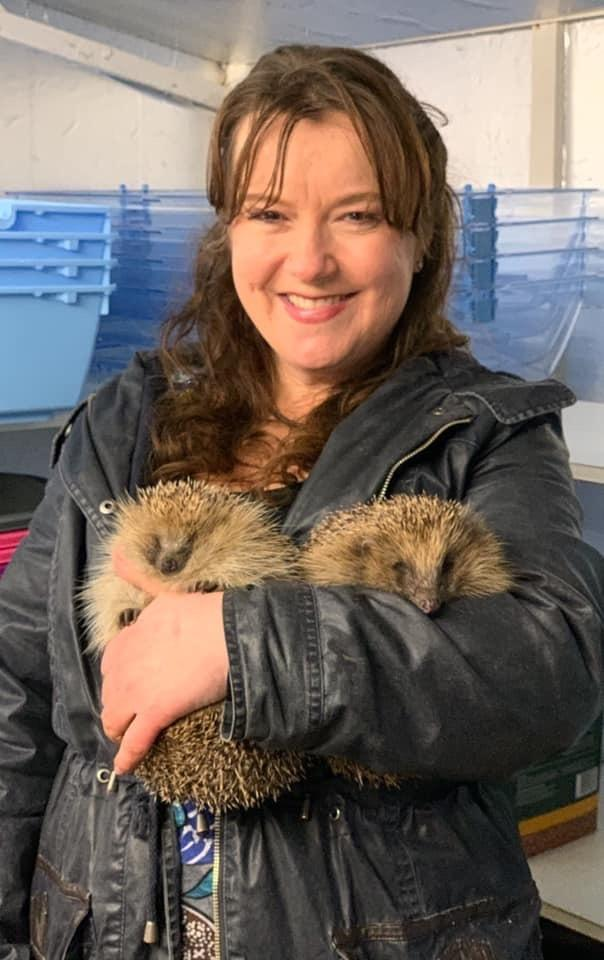 Ailie with a hedgehog.