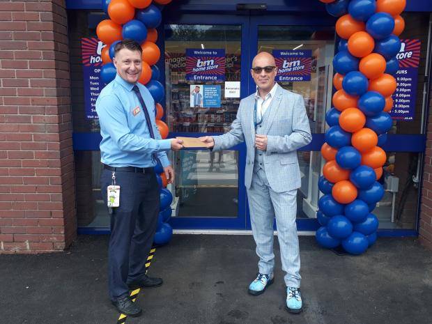 Kidderminster Shuttle: 'Coronavirus hero' Dale Preece-Kelly receives a voucher at the opening of Kidderminster's new B&M store