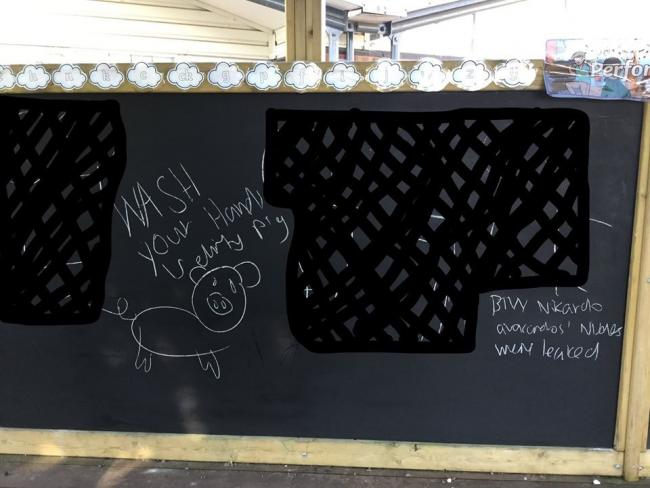 Graffiti left by the intruders on a chalk board at Franche Community Primary School in Kidderminster. Photo from Facebook