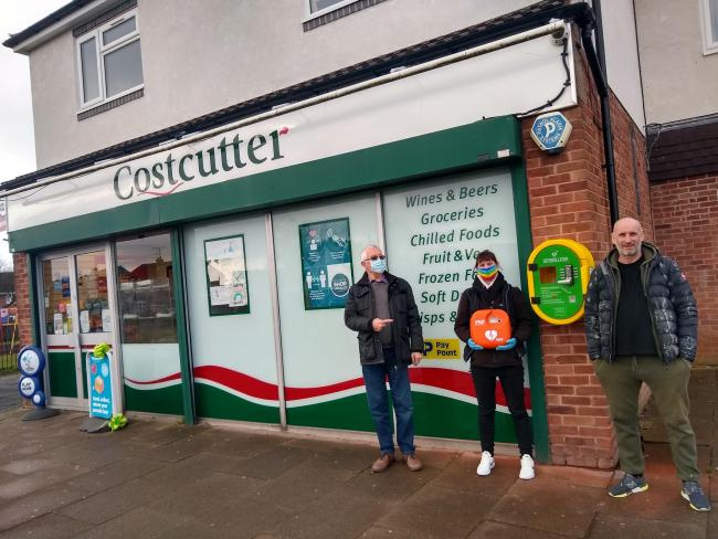 Peter Richards, from Droitwich AED, Beth Wilson, from Costcutter, and Steve Mayall, of SPM Building services with the new defib
