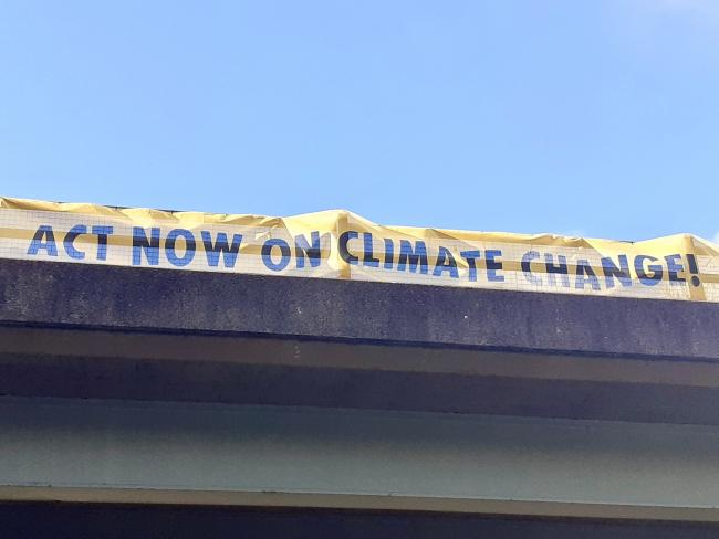 The Extinction Rebellion unfurled a nine-metre banner over the Bewdley Bypass urging the MP to support a new bill to tackle climate change