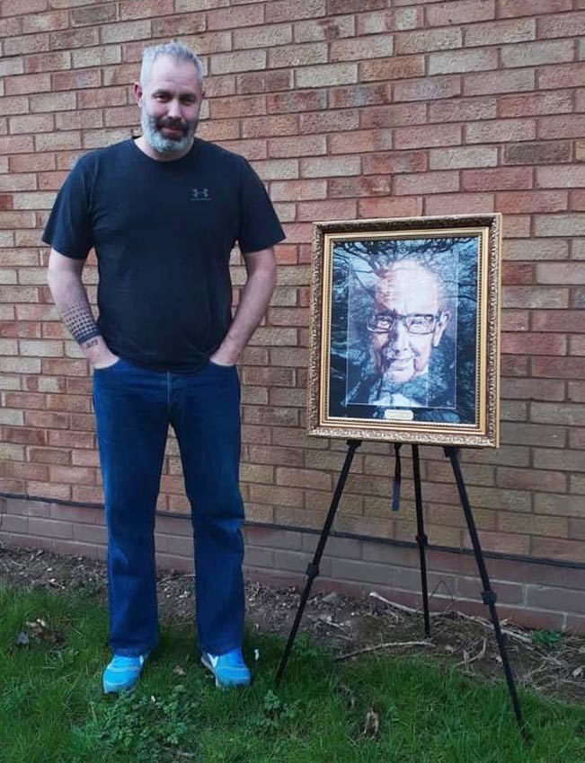 Artist Kevin Wills with his digital painting of Captain Tom