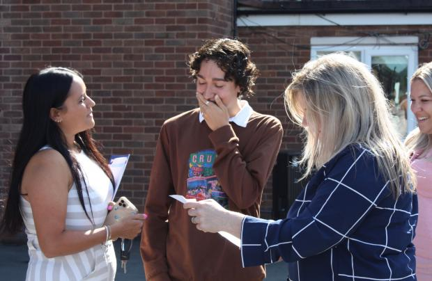 Kidderminster Shuttle: Stourport student Zach Savage opens his results envelope