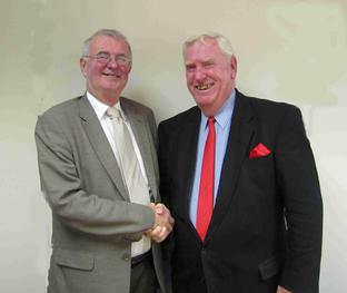 New member: Mike Kelly welcomes Howard Martin to the Labour Group.