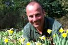 Blooming: Head gardener, Michael Darvill, with the daffodils.
