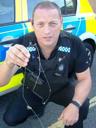 'Completely inhumane': Wildlife officer PC Simon Albutt with the illegal locking snare found at Blakedown.