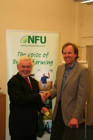Farm handshake: New county NFU chairman Clive Davies, left with outgoing chairman Tim Jones.