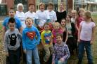 Kidderminster Soroptimists unveil  wooden bench at Birchen Coppice School
