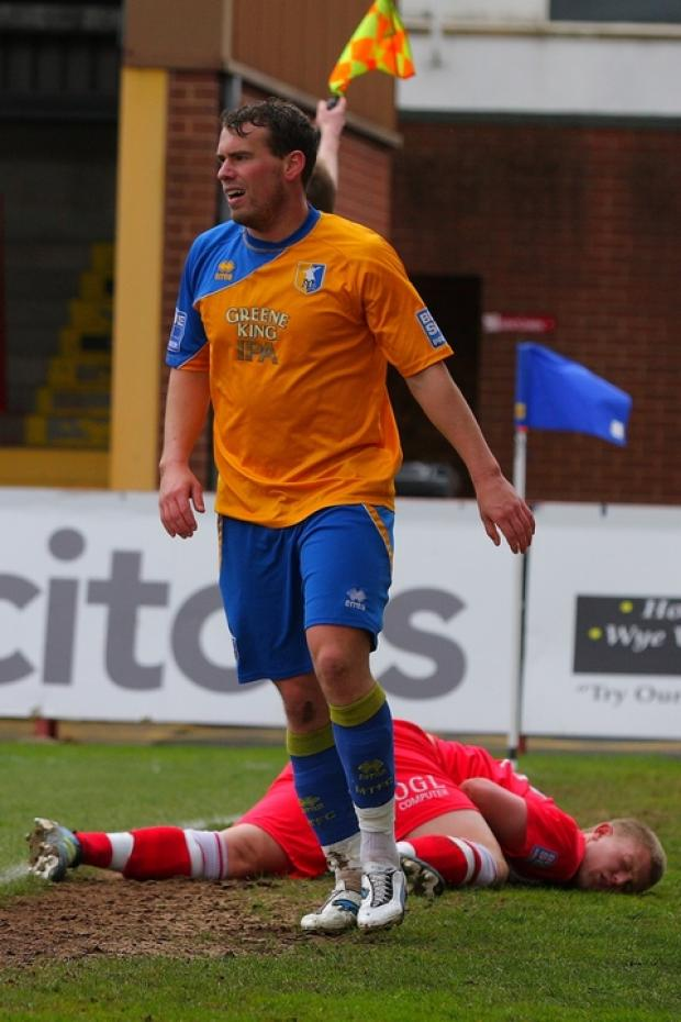 Anthony Malbon lies prostrate on the pitch after being fouled by Mansfield wide man Louis Briscoe. Picture: ADRIAN HOSKINS
