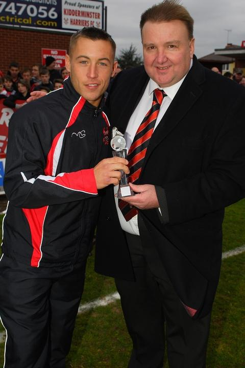 Efforts recognised: Lee Vaughan gets his award from chairman Mark Serrell. Pictures: ADRIAN HOSKINS