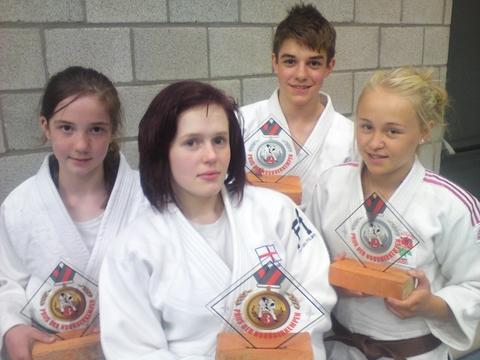 Sweet success in Belgium: Samurai quartet Bryony Griffiths, Charis Hancocks, Brendan Crummy and Frankie Marston show off the medals won in Antwerp.