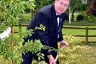Final act: Kidderminster Lions Club president Colin Hill plants a tree to mark the group's 37th charter anniversary.