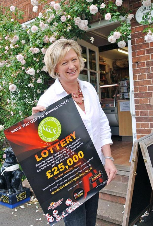 Winning Ticket: Shop owner Jayne Powell launches Chaddesley Corbett's local lottery. Buy this photo 271246LA at kidderminstershuttle.co.uk or by calling 01562 633333.