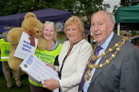 Name the bear: Kidderminster Lions Club member Helen White with the teddy and Mayor John Aston and Mayoress Madeleine Craddock. Photo: Colin Hill.