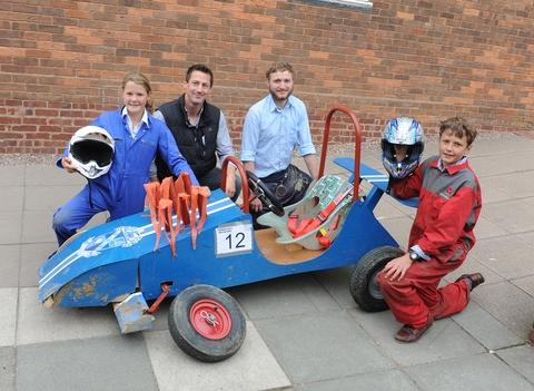 Eyes on the prize: From left, Elizabeth Walker, teachers James Abbott and Jordan Scott and Roddy Philips hope to win the next soap box derby.