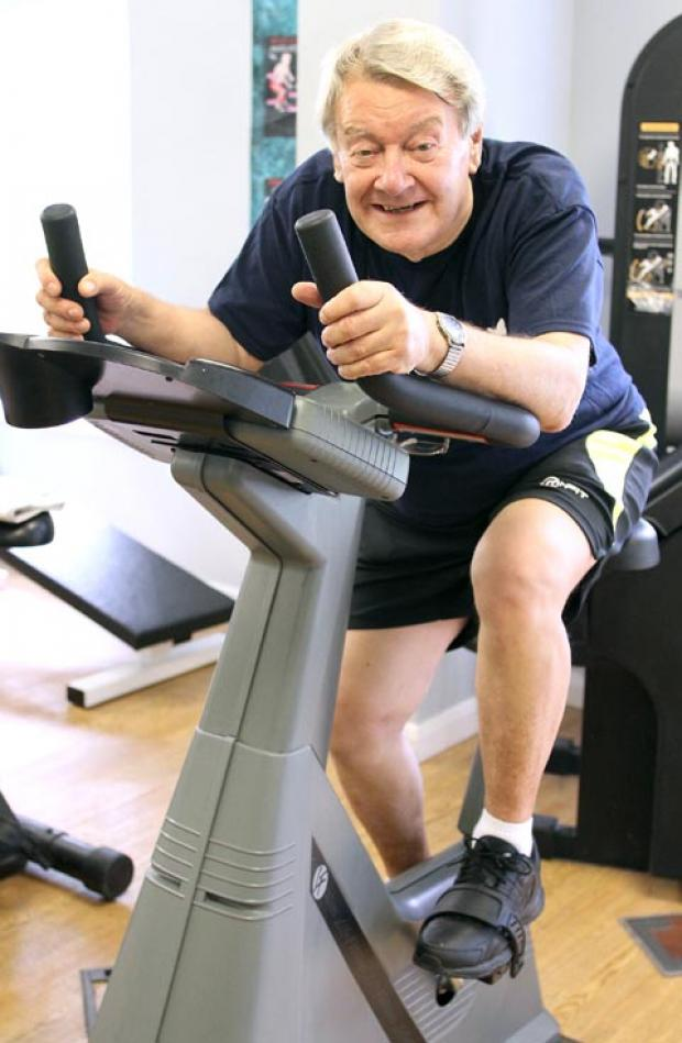 Wheels in motion: Graham Bolton on the exercise bike.