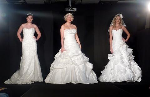 Bridal style: Gowns modelled on the catwalk at the spring show at Worcester Rugby Club.