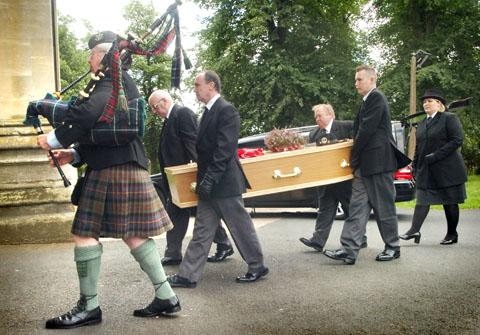 Final farewell: Piper Colin Hughes leads the procession into St George's Church during Jack Gillespie's funeral. Buy this photo 371202L at kidderminstershuttle.co.uk/pictures or by calling 01562 633333.