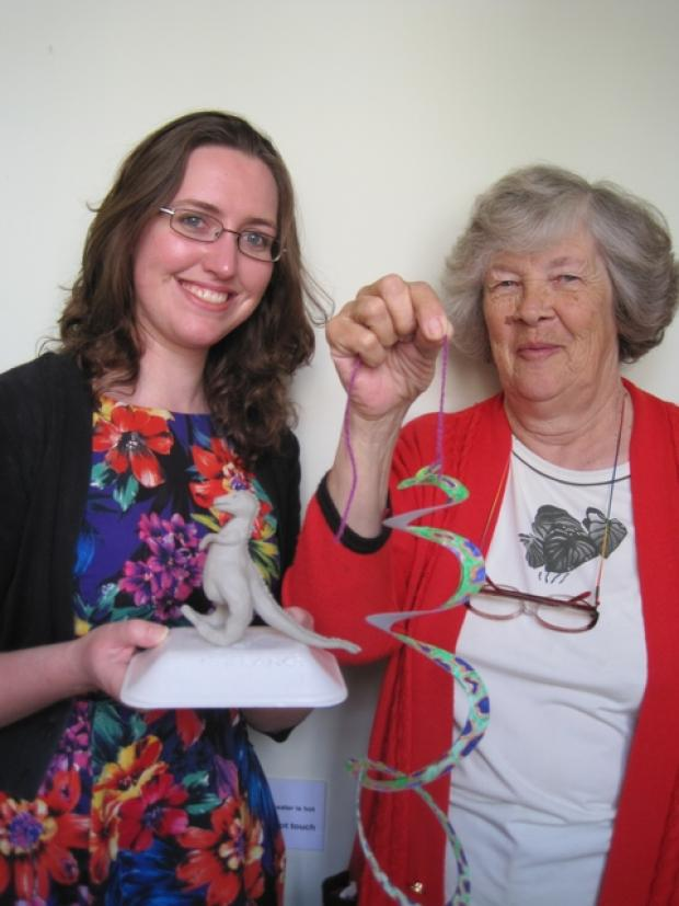 Doing their bit: Volunteers Beth Broadway, 23 and Diana Foster, 72 supervising dinosaur-themed craft activity sessions.