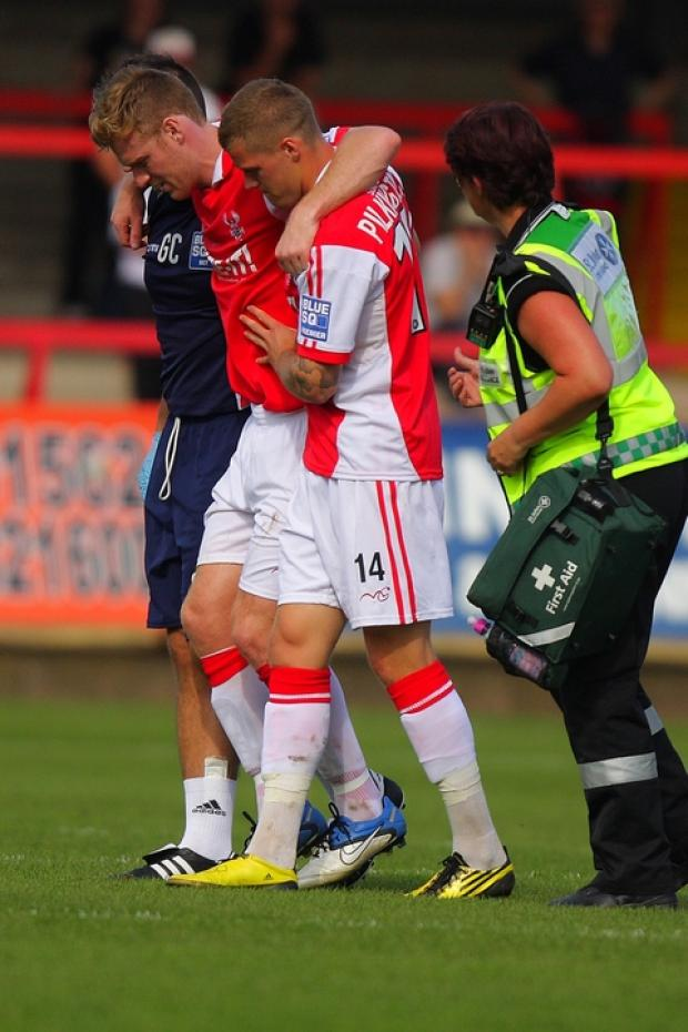 Injury blow: Kyle Storer limps off injured on Saturday's draw. Picture: ADRIAN HOSKINS