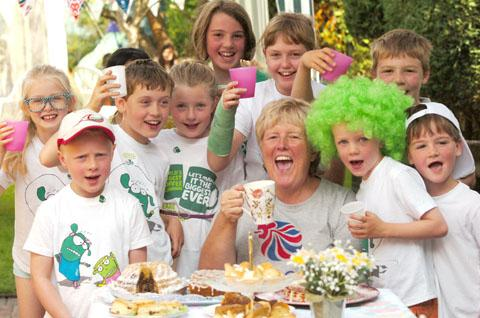 Party time: Karen Rawlings and her guests raise a mug for Macmillan Cancer Support.