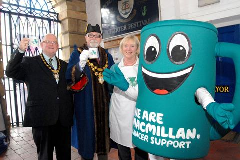 Raise a mug: From left, Consort Wilf Talbot, Mayor John Latham and Macmillan area fundraising manager Hilary Al Rasheed with the Macmillan coffee mug.