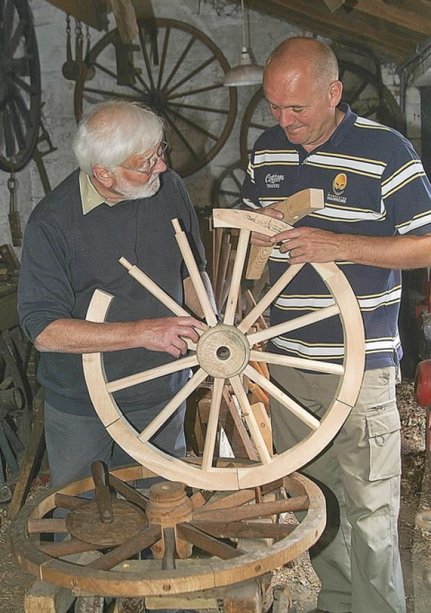Learning skills: Ced Lewis, left and Mark Clements with a wheel Mr Clements has made.
