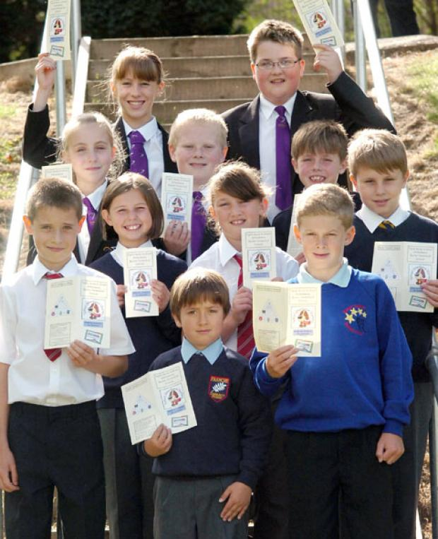 Promoting attendance: Kidderminster pupils with their leaflet. Buy this photo 381230L at kidderminstershuttle.co.uk/pictures or by calling 01562 633333.