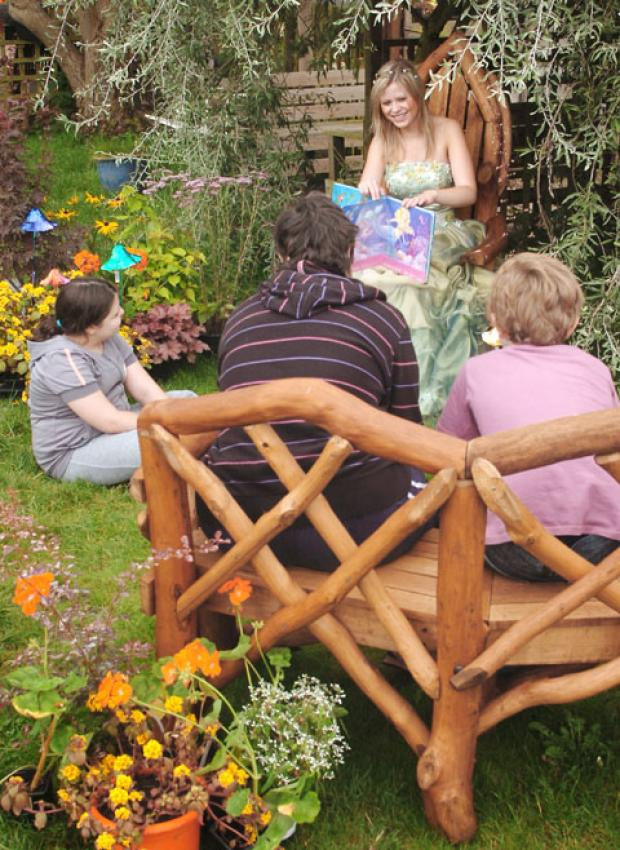 Fairy tale: Victoria Weston reads to young service users in the garden's story telling corner. Buy this photo 341246L at kidderminstershuttle.co.uk/pictures or by calling 01562 633333.