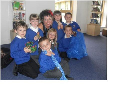 Story time: Katrice Horsley, with pupils clockwise from back left, Ben Unitt, Lauren O'Connell, Libby Edgenton, Joshua Calvert, Dominic Baker, Alisha Littleton and Ethan Hodgetts.