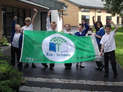 Going Green: Pupils with their green flag.