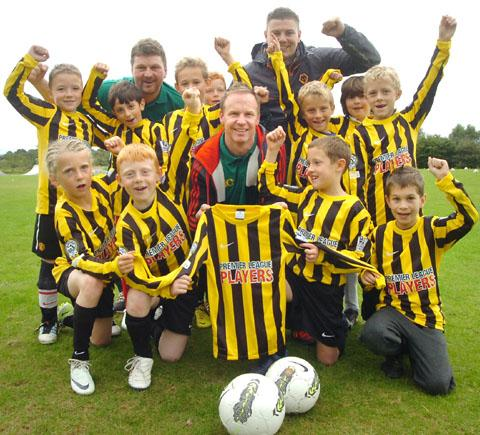 New kit: Jody Craddock, centre with the Cookley Tigers under 9s team and Derek Williams, back left and Wolves community officer Steve Cullis, right.