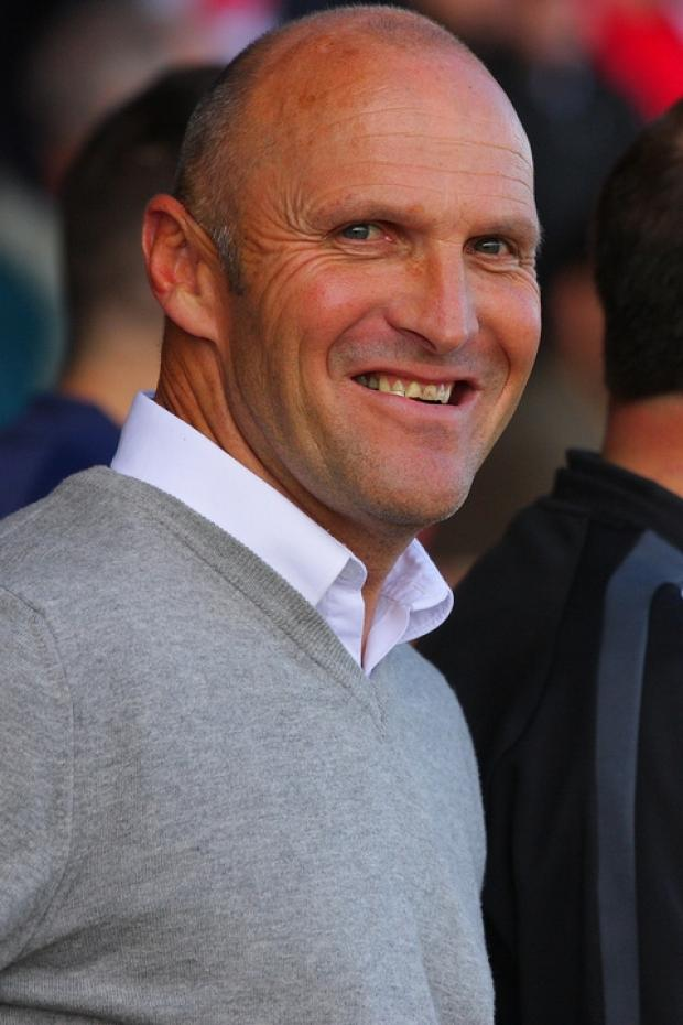 All smiles: Steve Burr has been pleased with Harriers' defensive qualities. Picture: ADRIAN HOSKINS
