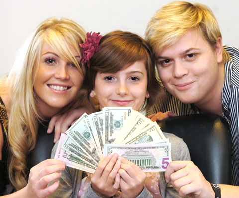 Make a wish: Macey Littleton, with her dollars and salon staff Kera Bennett and Lloyd Baker.