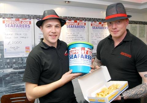 Frying high: Merchant staff James Hughes, left and Richard Elzner collecting money at the fish bar in October. 411239M