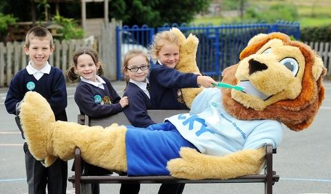 Brushing up: From left, Wilden All Saints pupls Adam Clarke, Alice Smith, Maddison Philpotts and Eva Bayley with Lucky the Lion.
