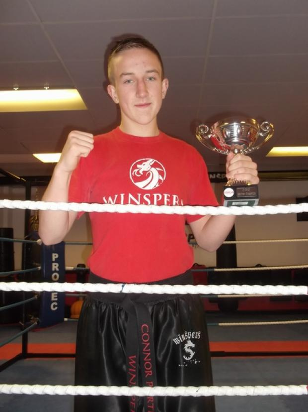 It's a knockout: Kickboxer Connor Porter, 16, won the light contact British championship in Birmingham.