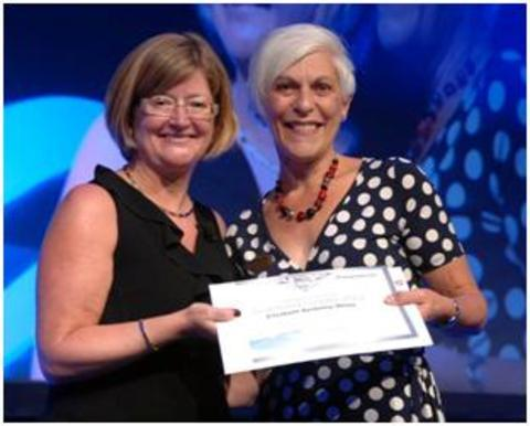 Diamond leaders: Weight Watchers UK operations director Samantha Rhodes presents Liz Berkely-White with her award.